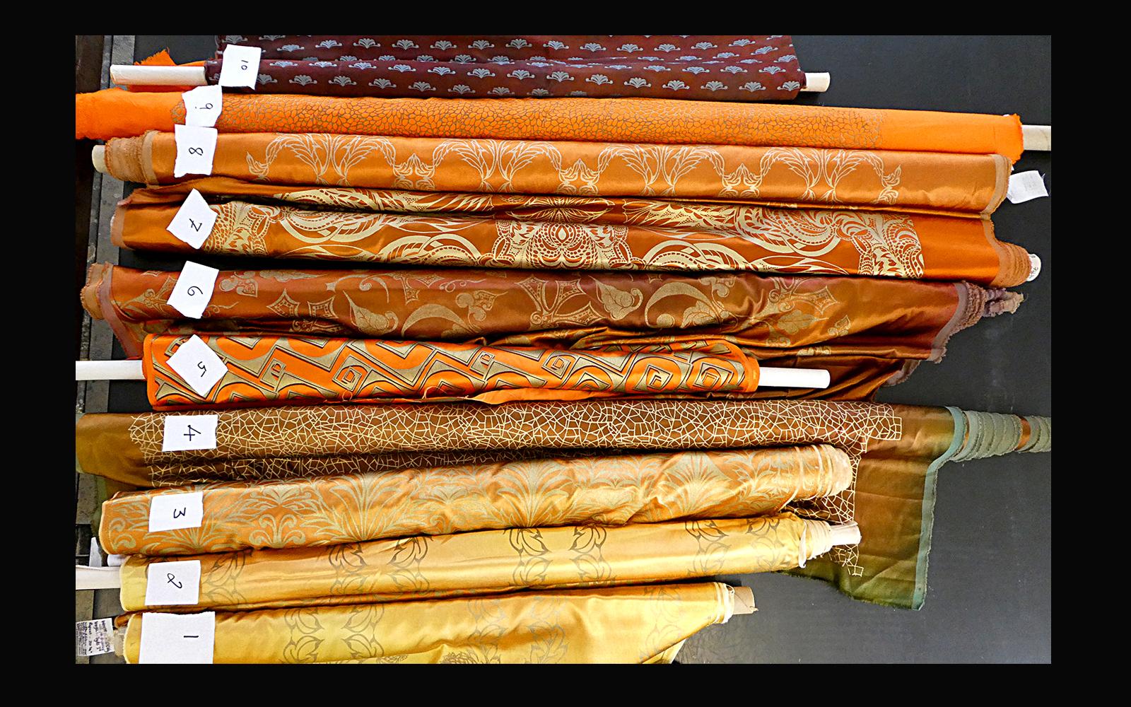 Fabric remnants drama opera golds ginger orange